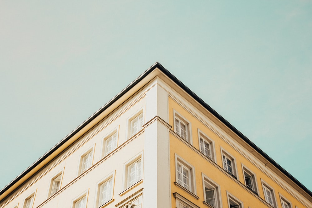 low-angle photography of building edges
