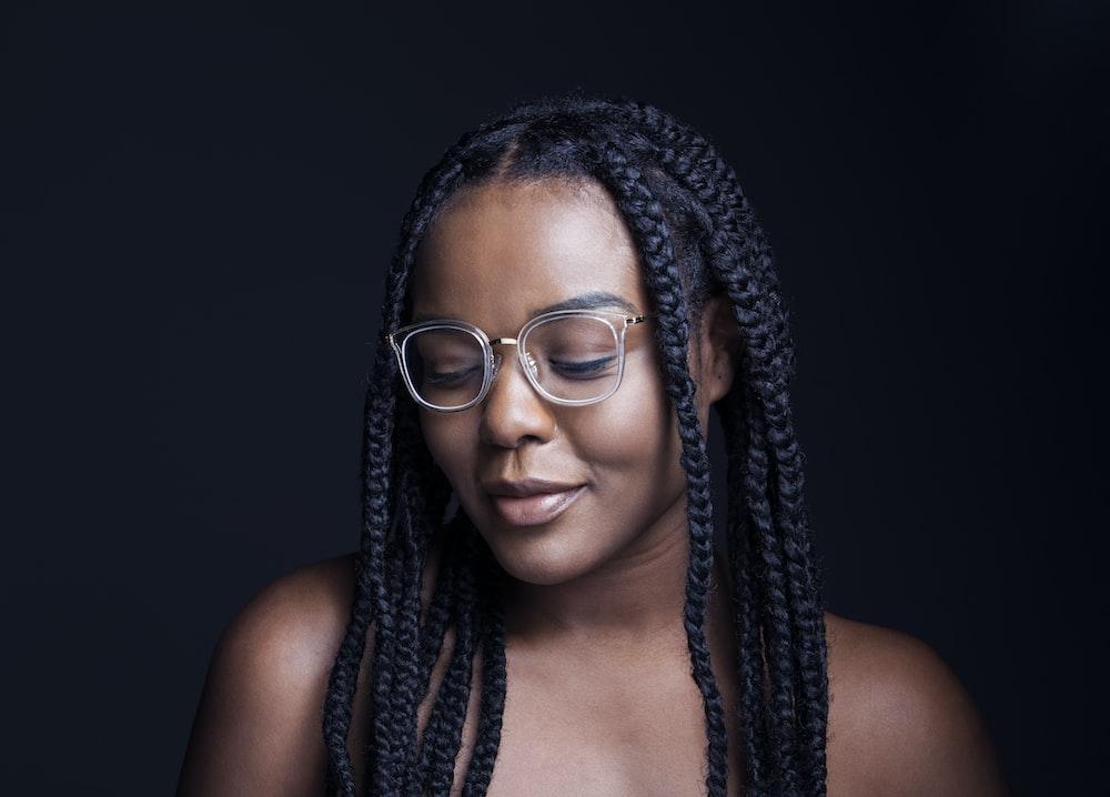 woman wearing eyeglasses looking down