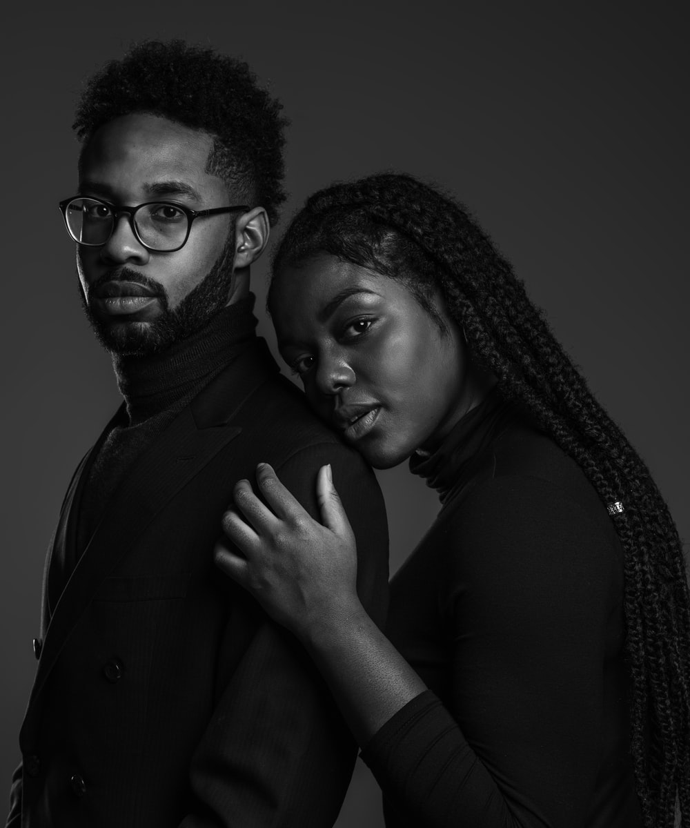 grayscale photo of man and woman posing