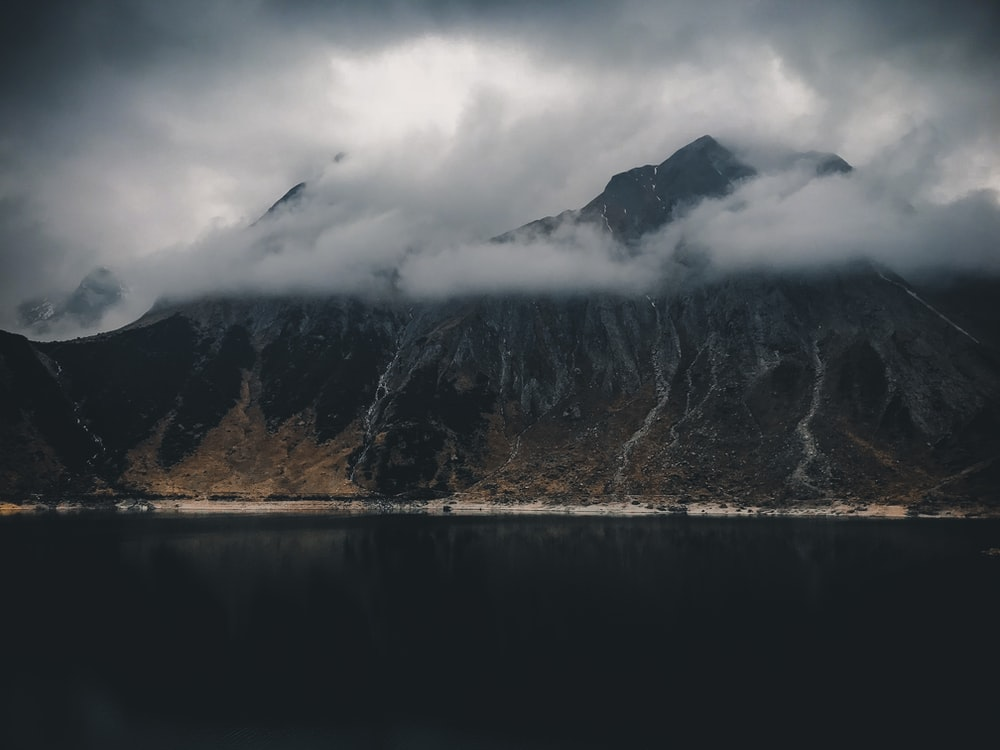 mountain in-front body of water