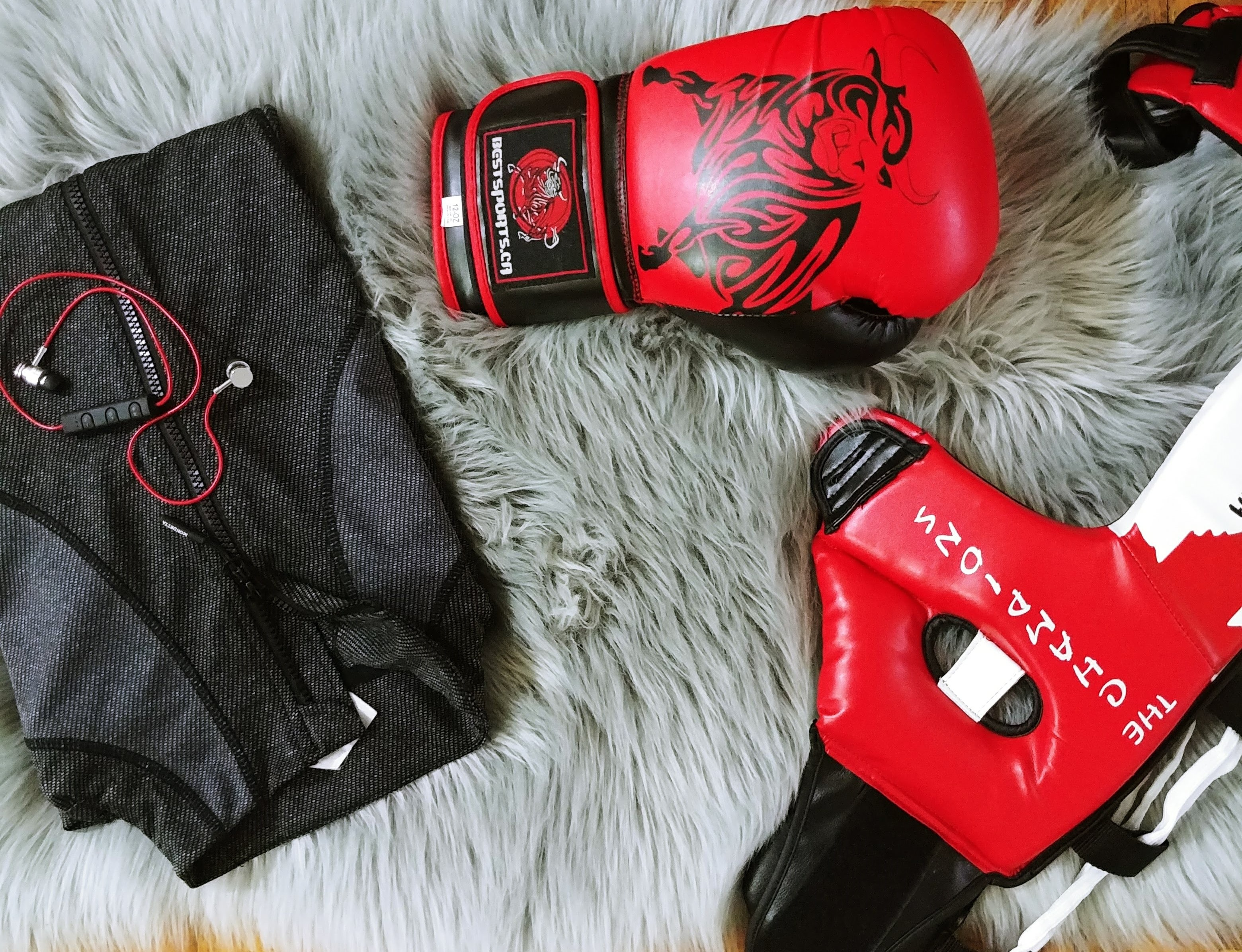training glove, mask, and zip-up jacket