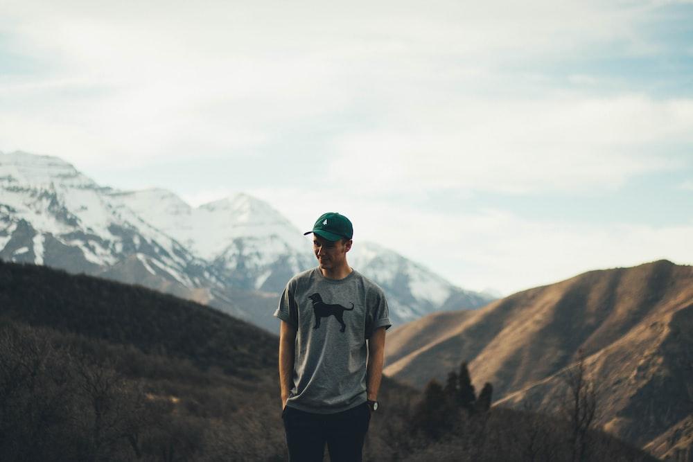 man standing on mountain range