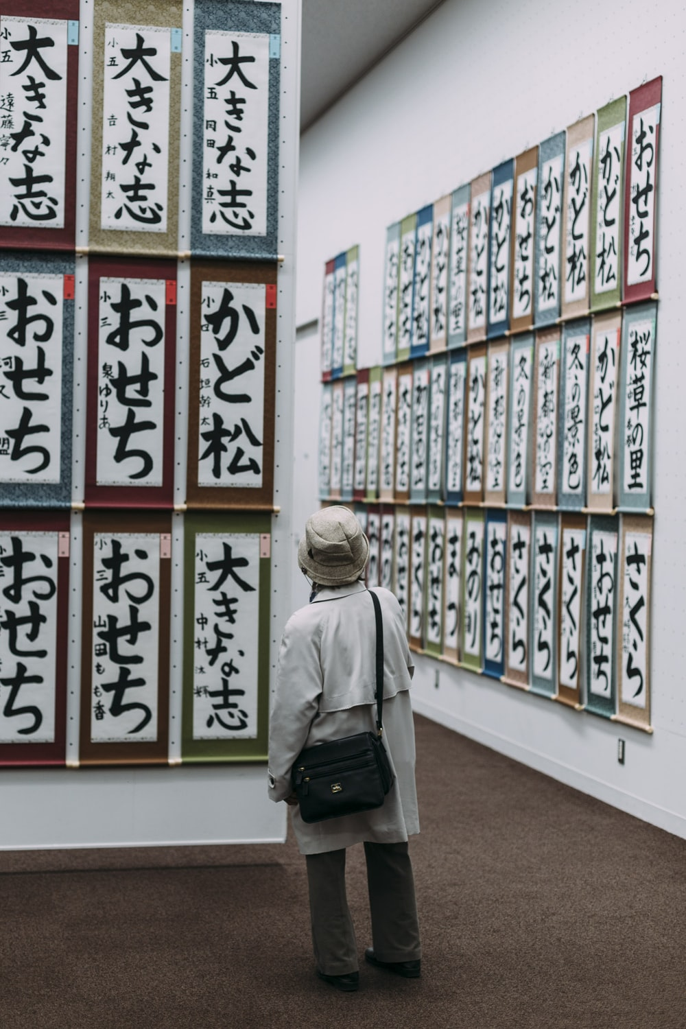 woman standing in front of scrolls