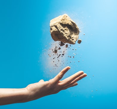person throwing rock