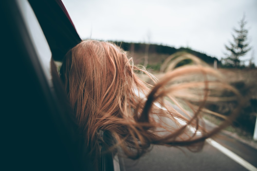 woman looking outside car window