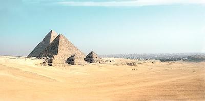 pyramid of giza during daytime pyramids teams background
