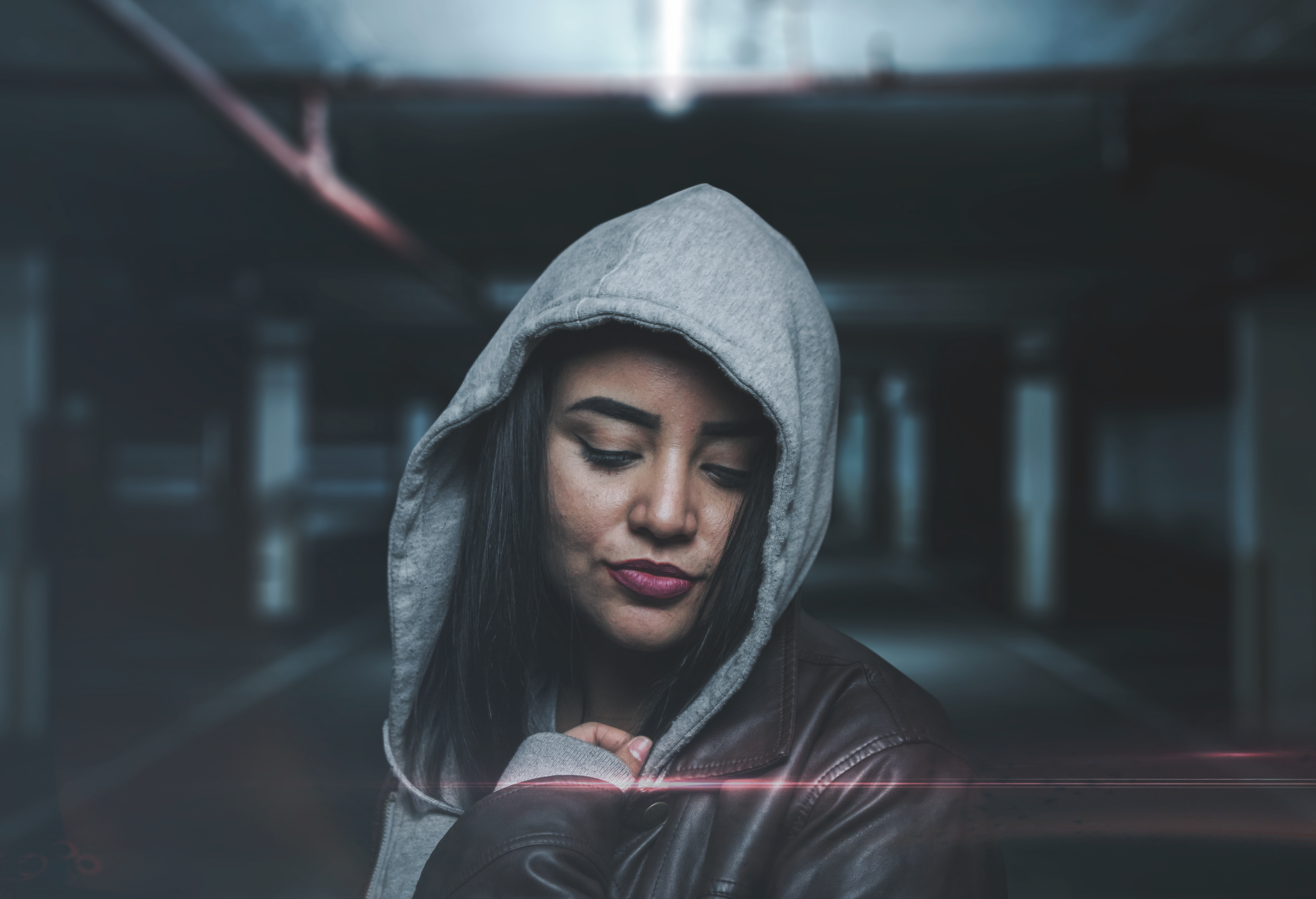 selective focus of woman wearing gray hoodie