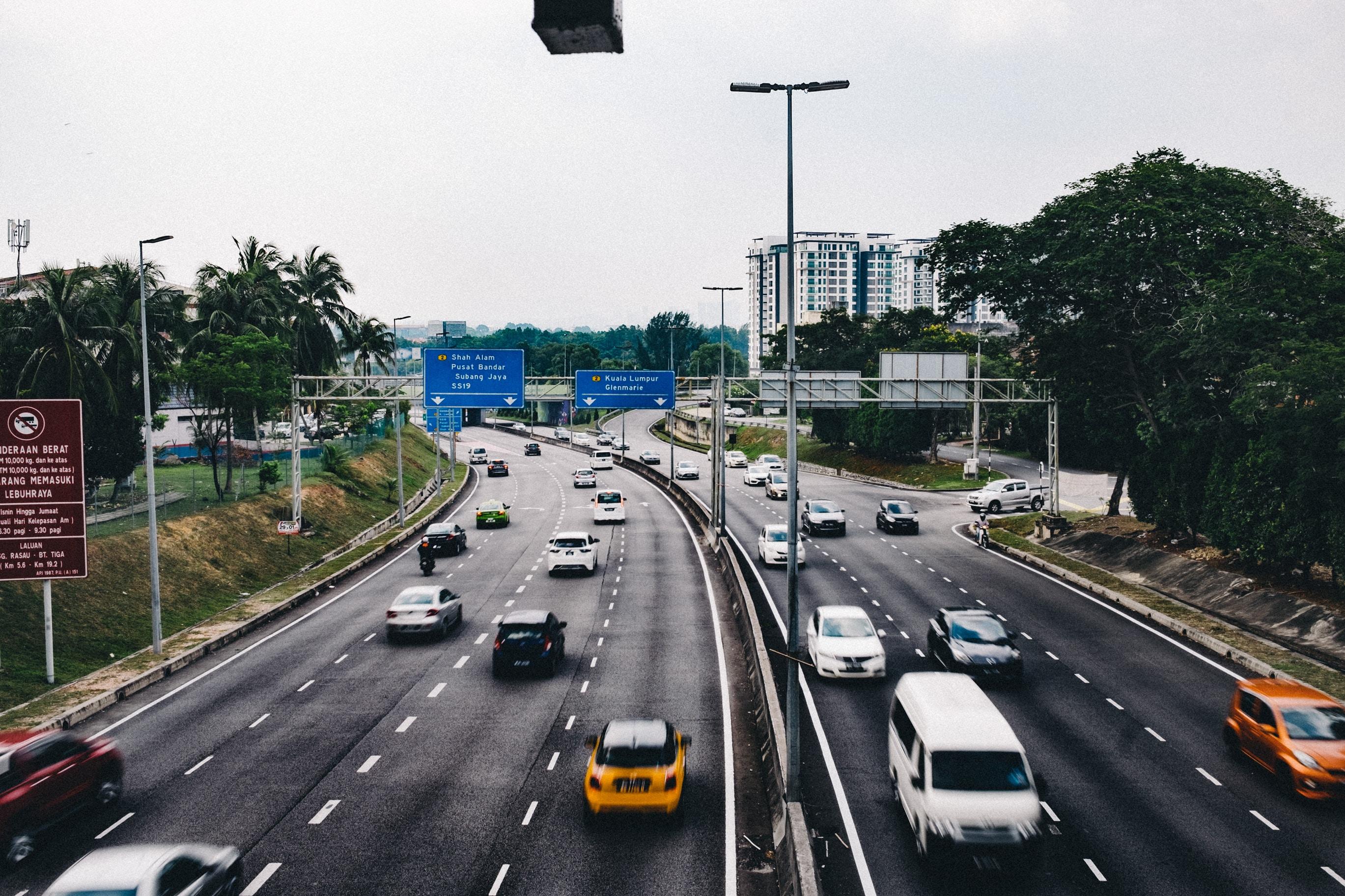 cars on black asphalt road during day time