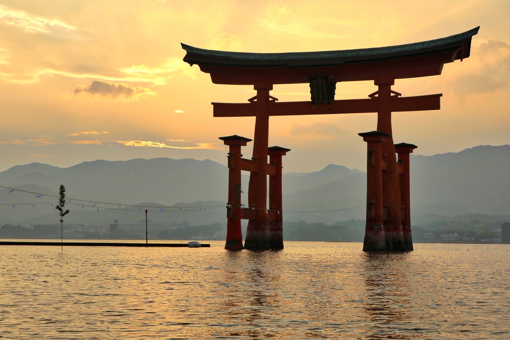 Torii surrounded with water at golden hour