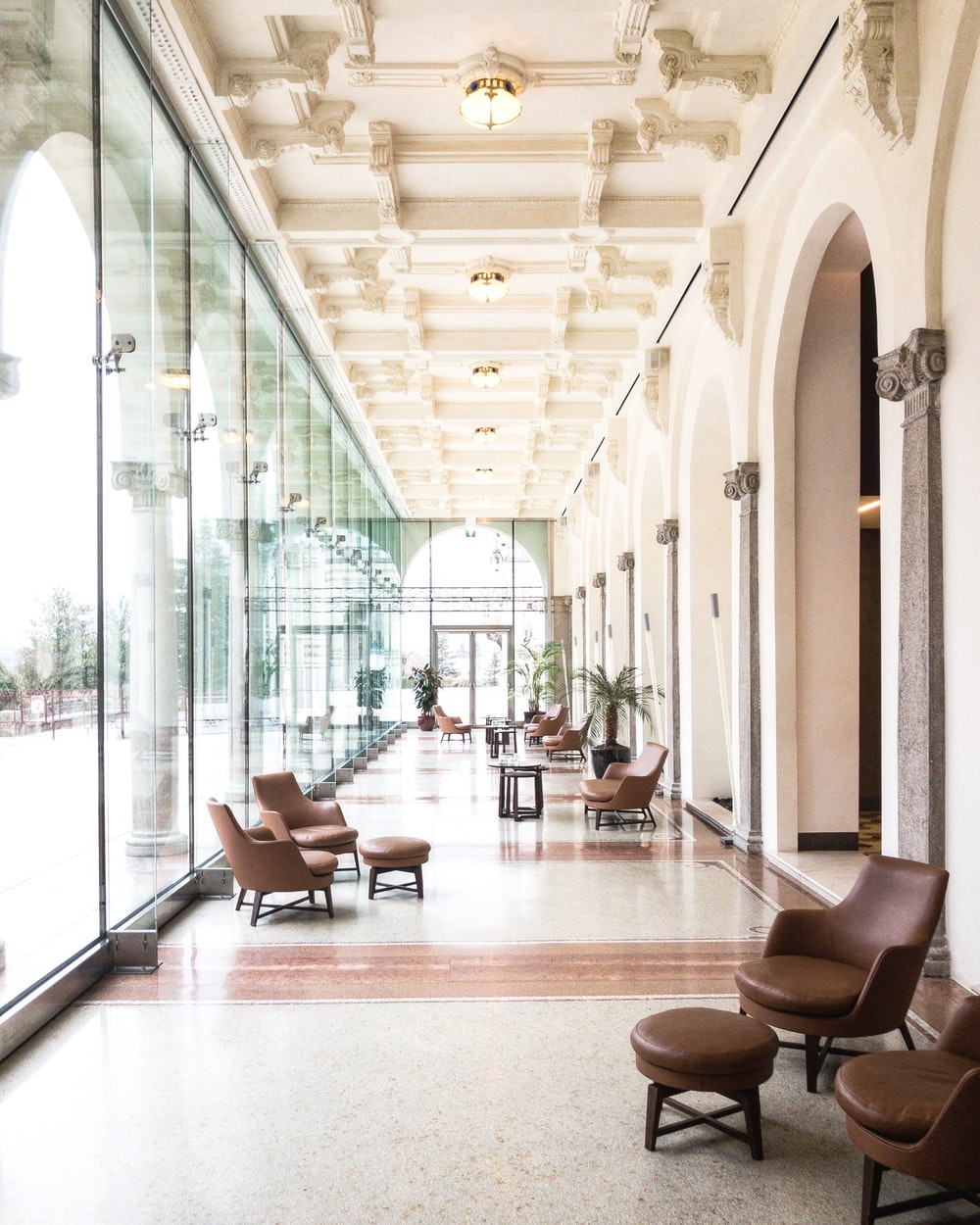 empty hallway beside glass wall