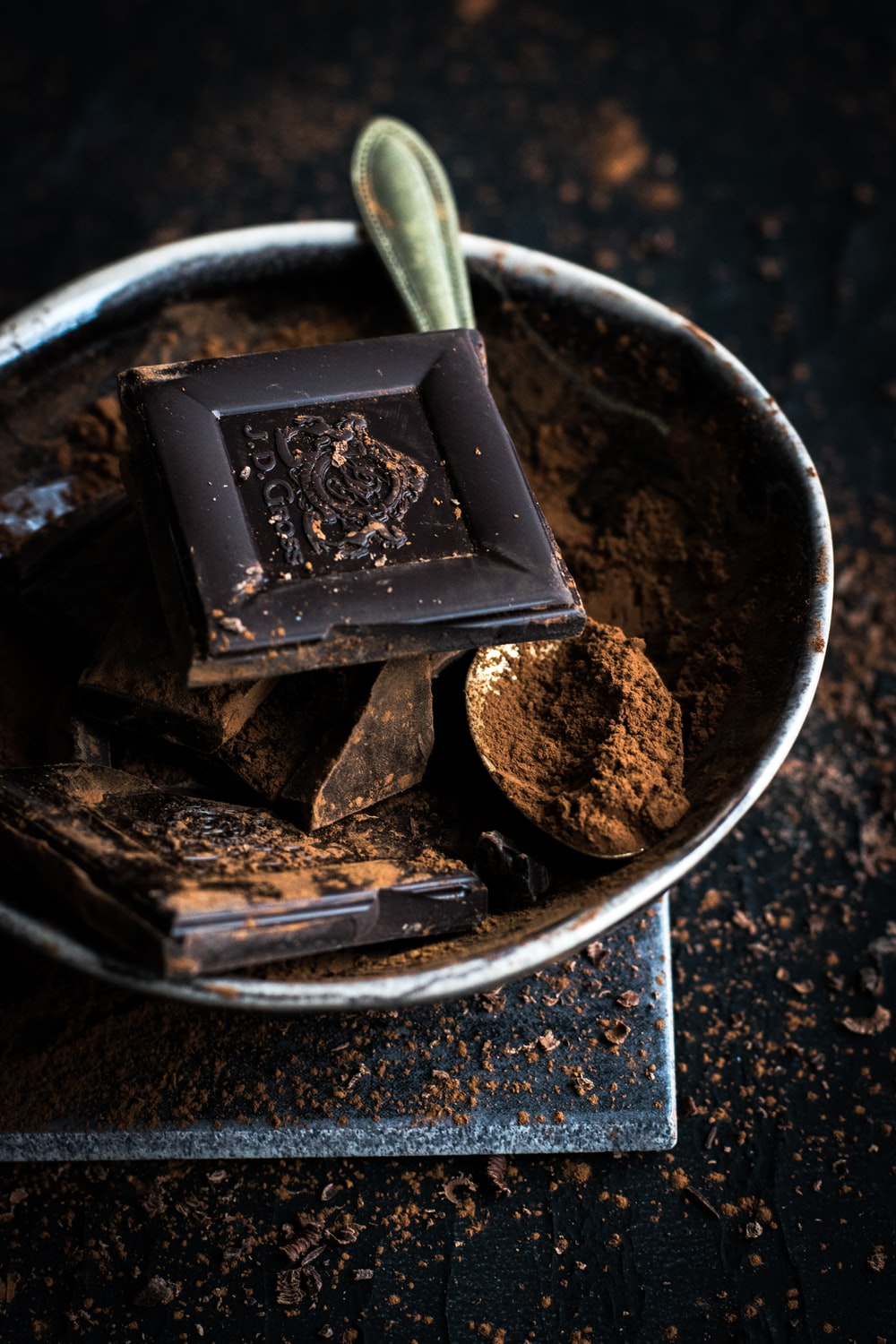 chocolate bar and powder in bowl