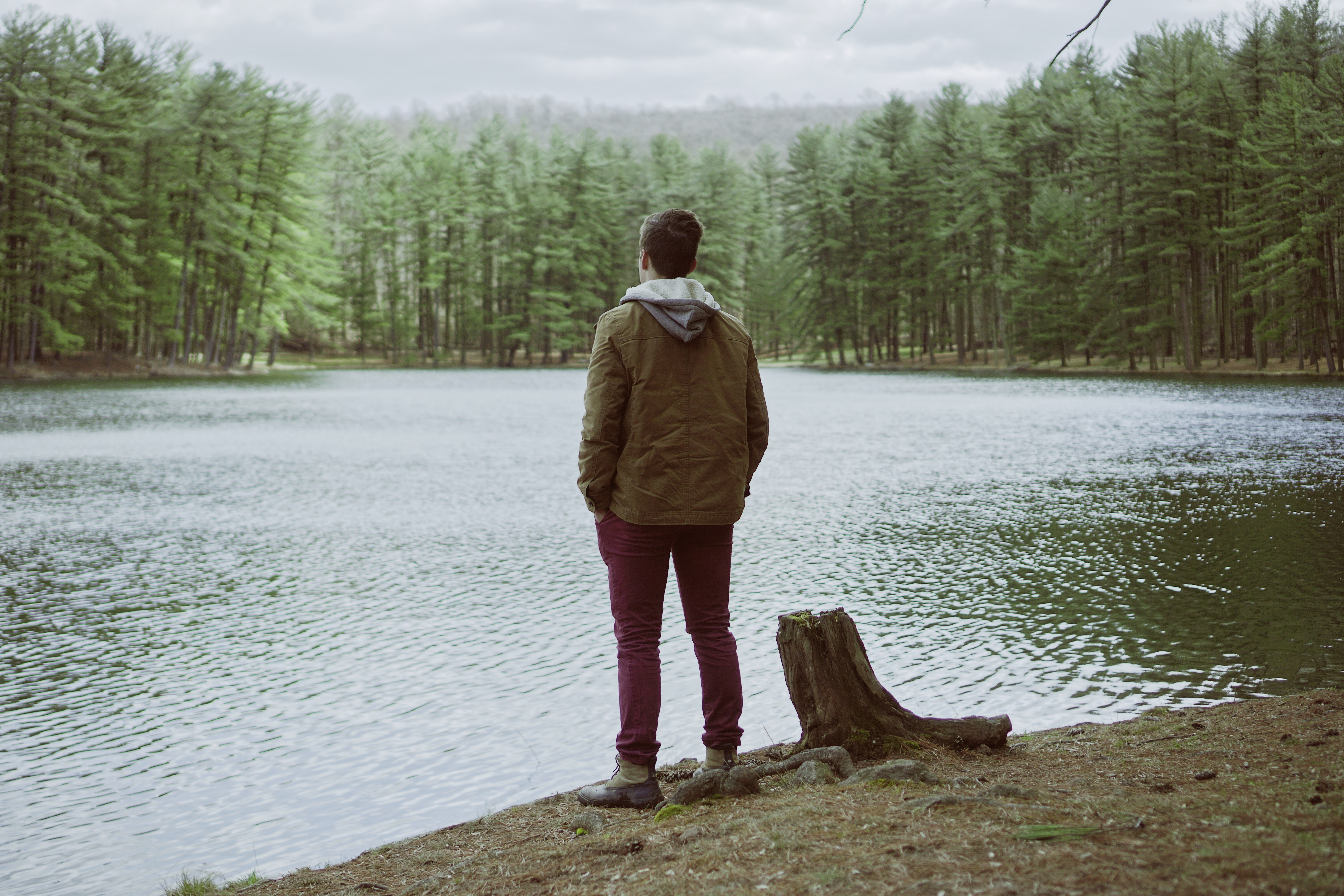 man standing near body of water