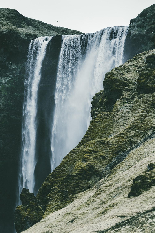 waterfalls near rock mountain