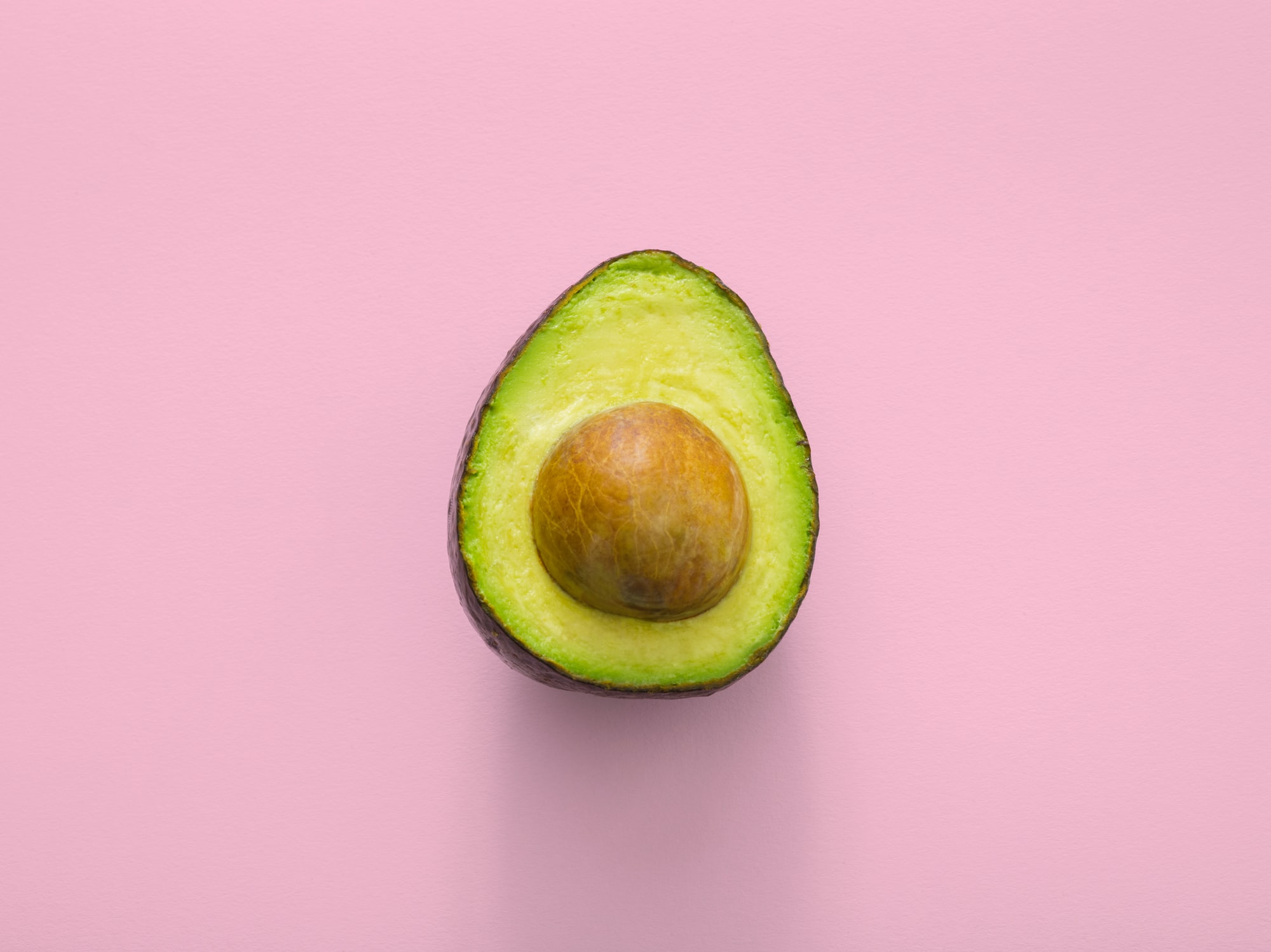 Avocado is a green rainbow food by www.thoughtcatalog.com for Unsplash