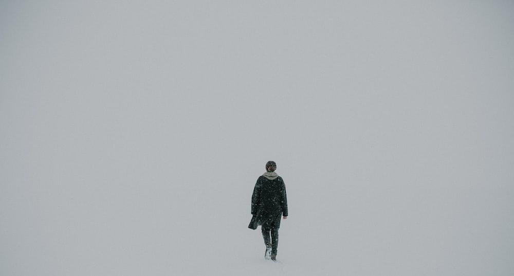 man walking on white surface
