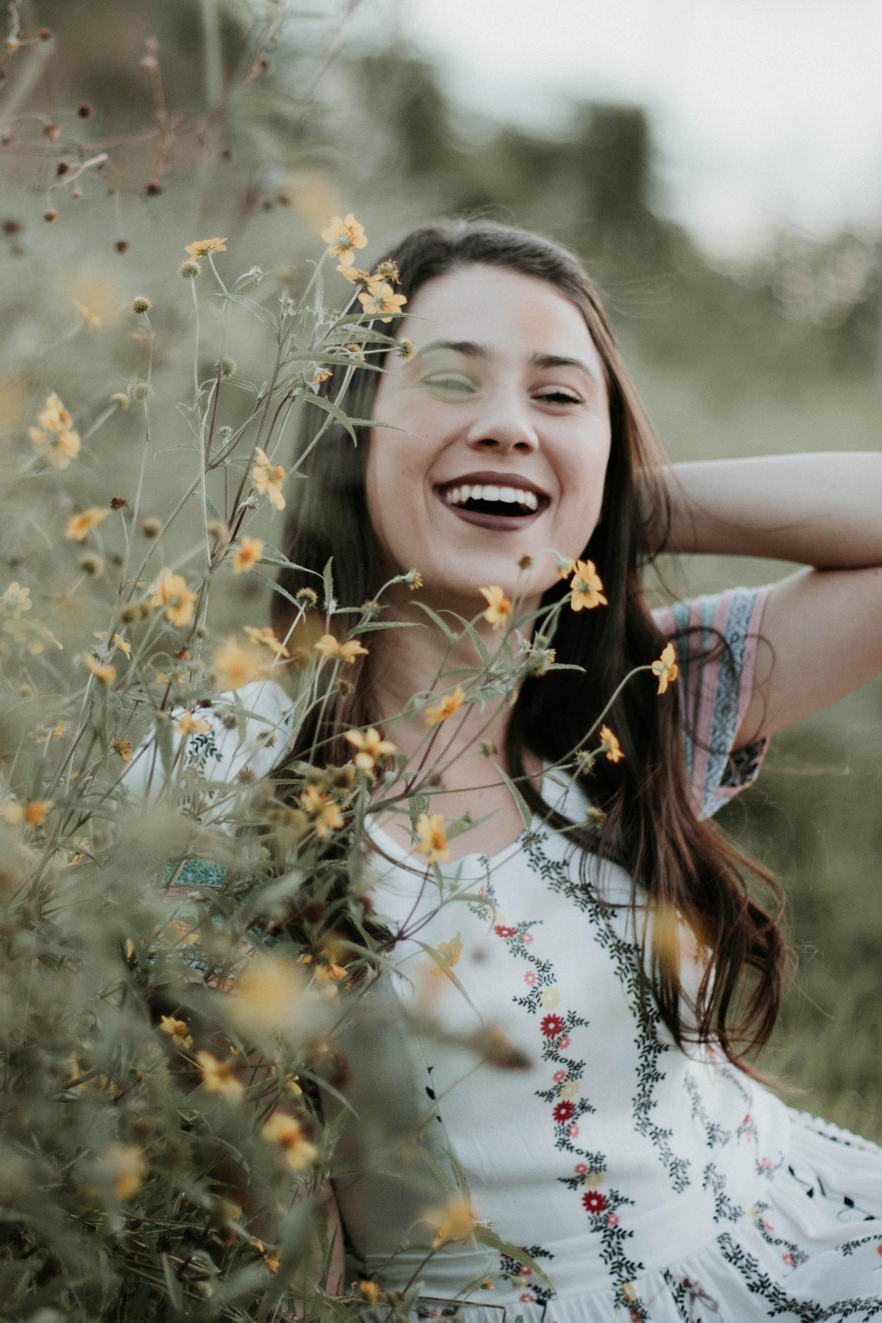 woman behind yellow petaled flowers