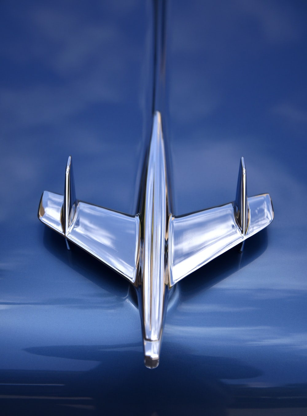 silver car plane emblem