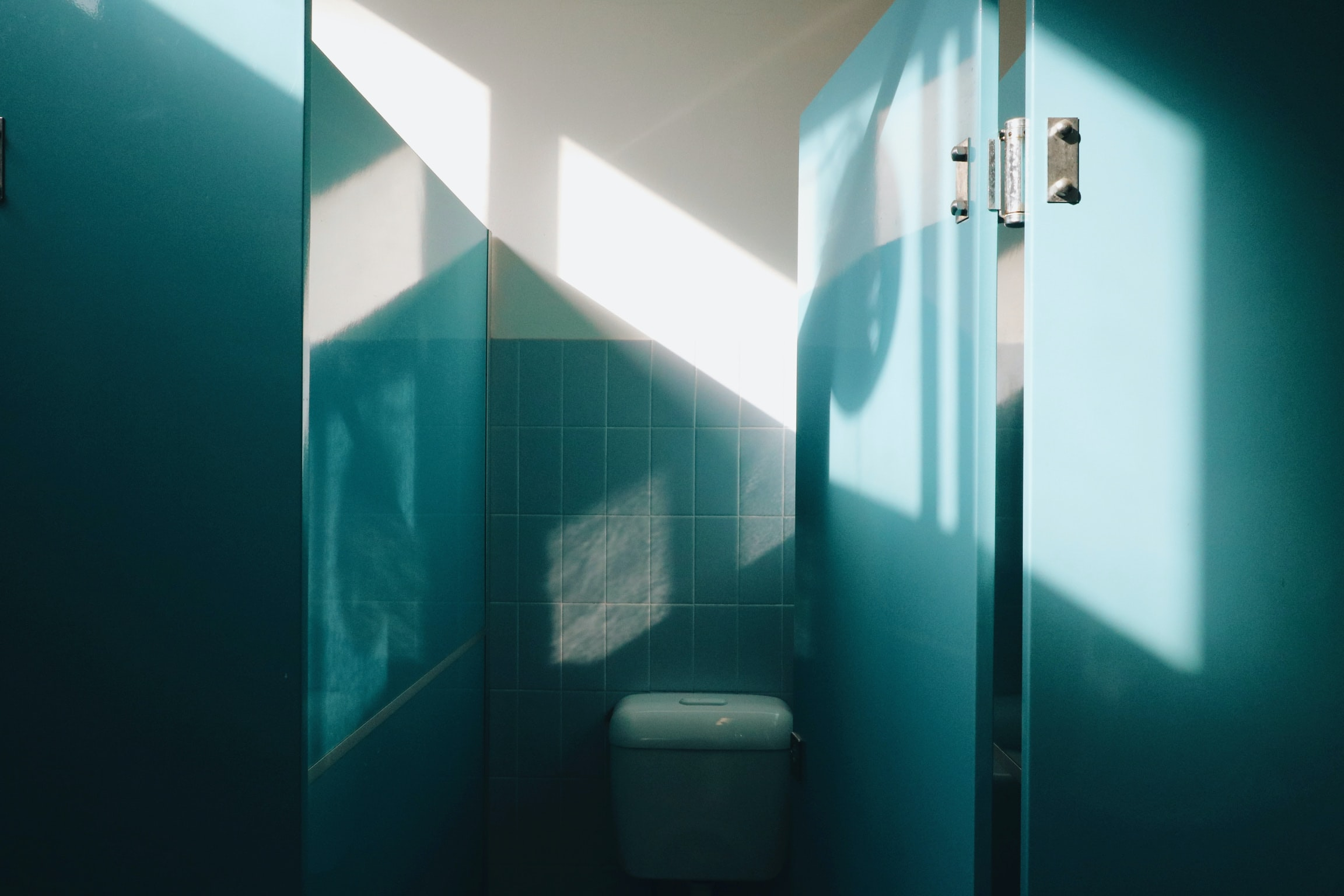 vacant white toilet sink