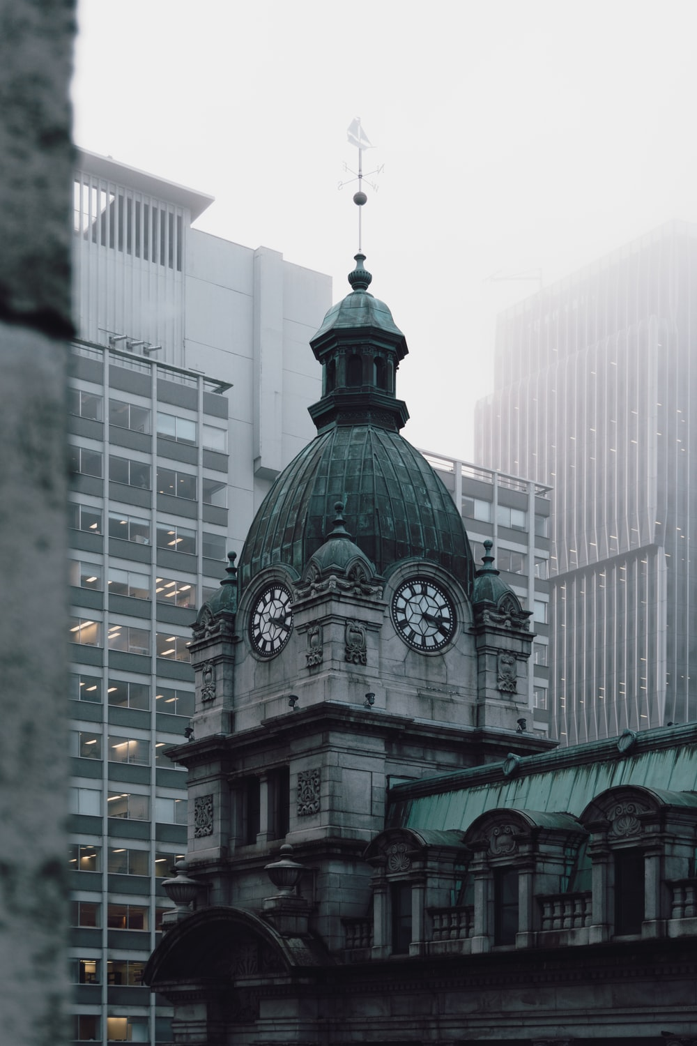 dome concrete building with clock at daytime