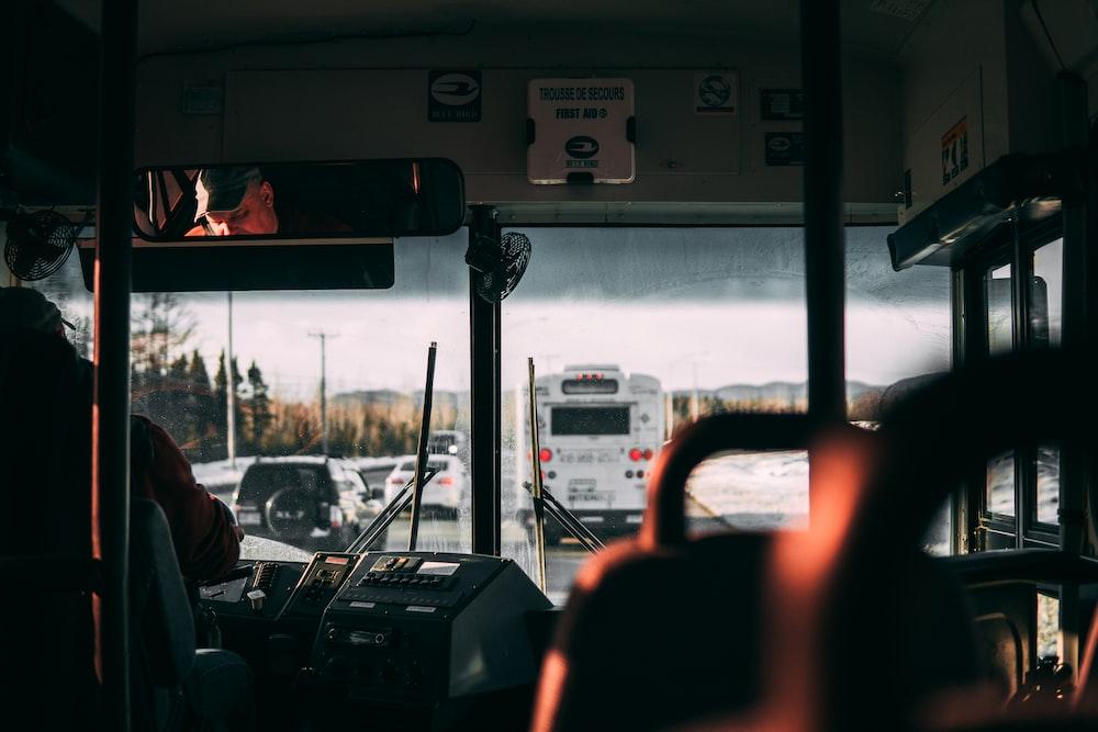 man riding bus