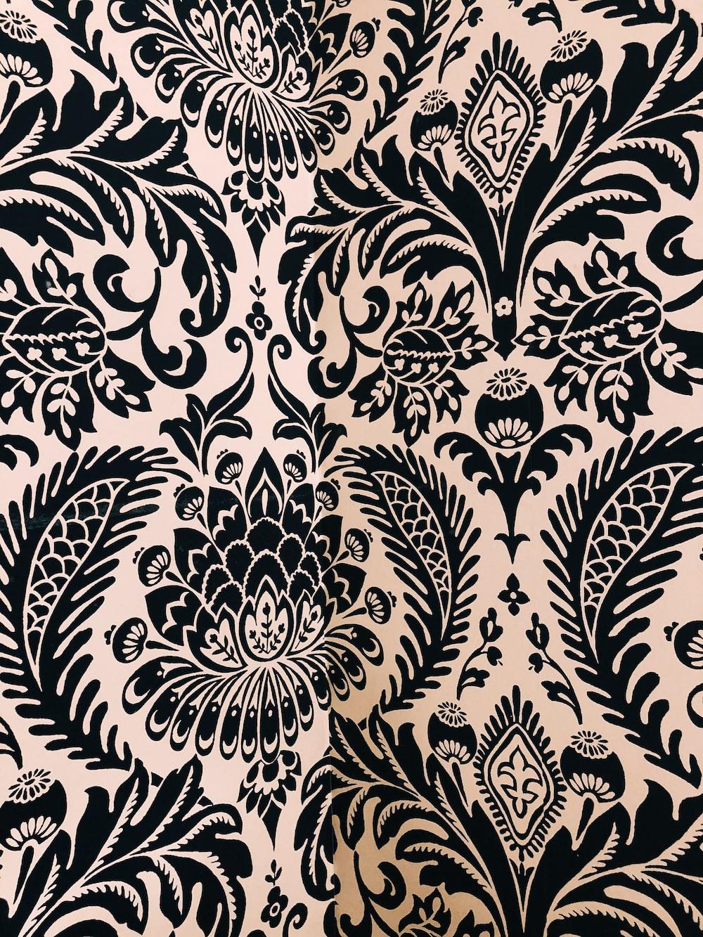 white and black damask textile