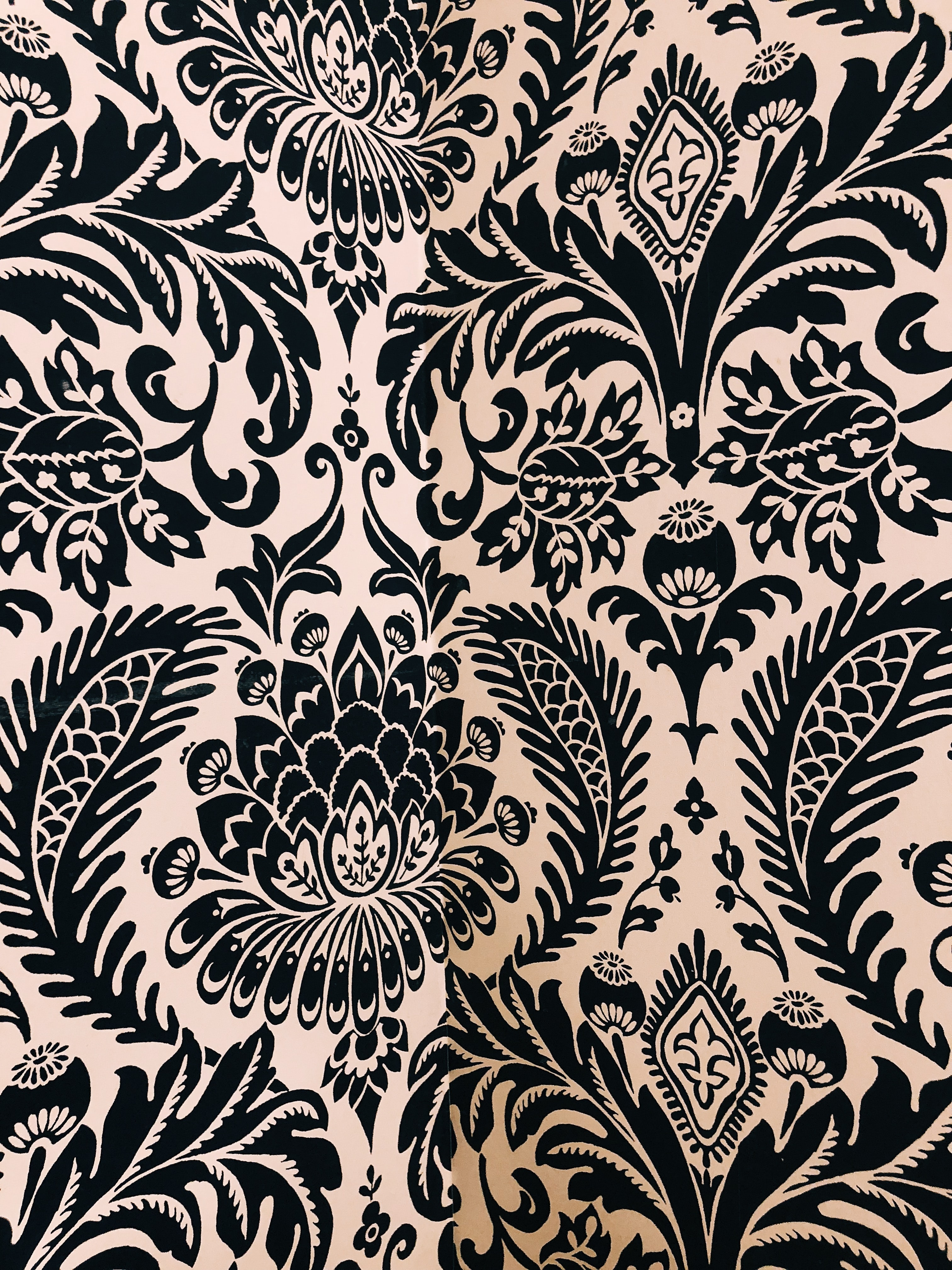 white and black damask textile