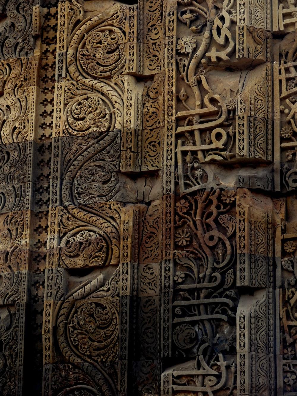closeup photo of wooden engraved wall decor
