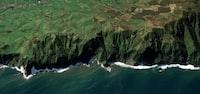 birds eye view of cliff near body of water