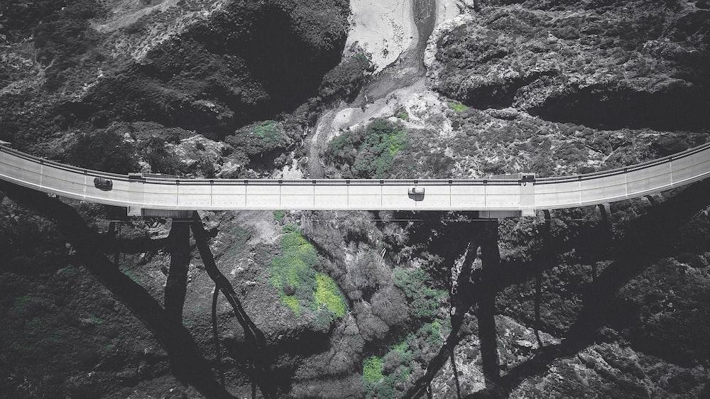 bird's eye view of gray concrete bridge