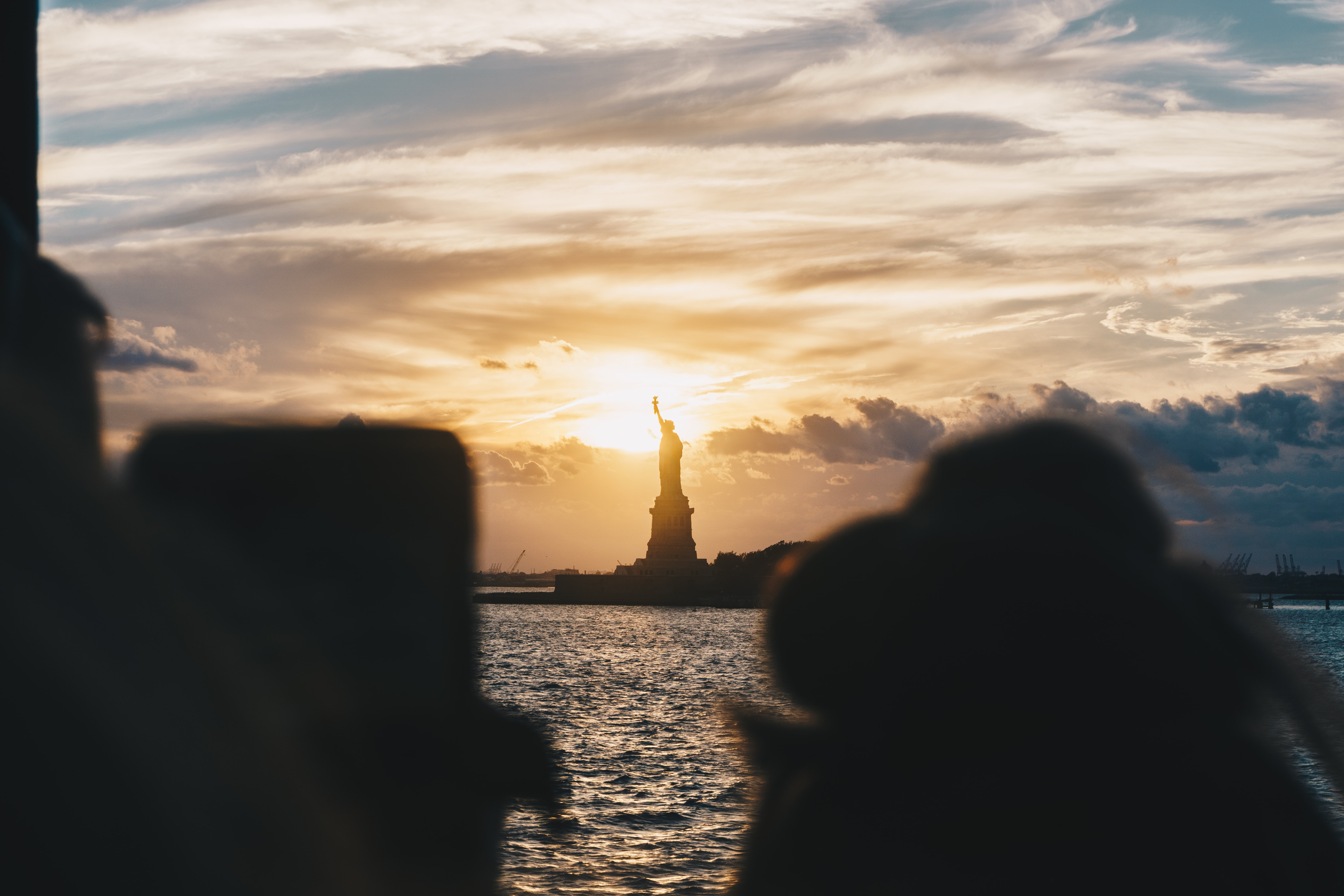 silhouette of Statue of Liberty, New York during golden hour