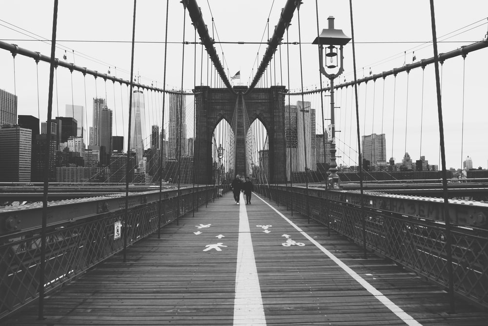 person walking on Brooklyn Bridge
