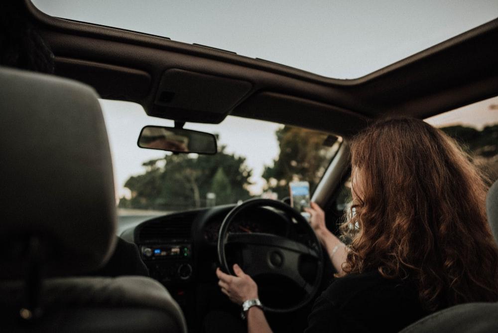 woman inside car driving