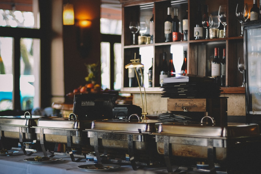 gray food containers near bar counter inside room