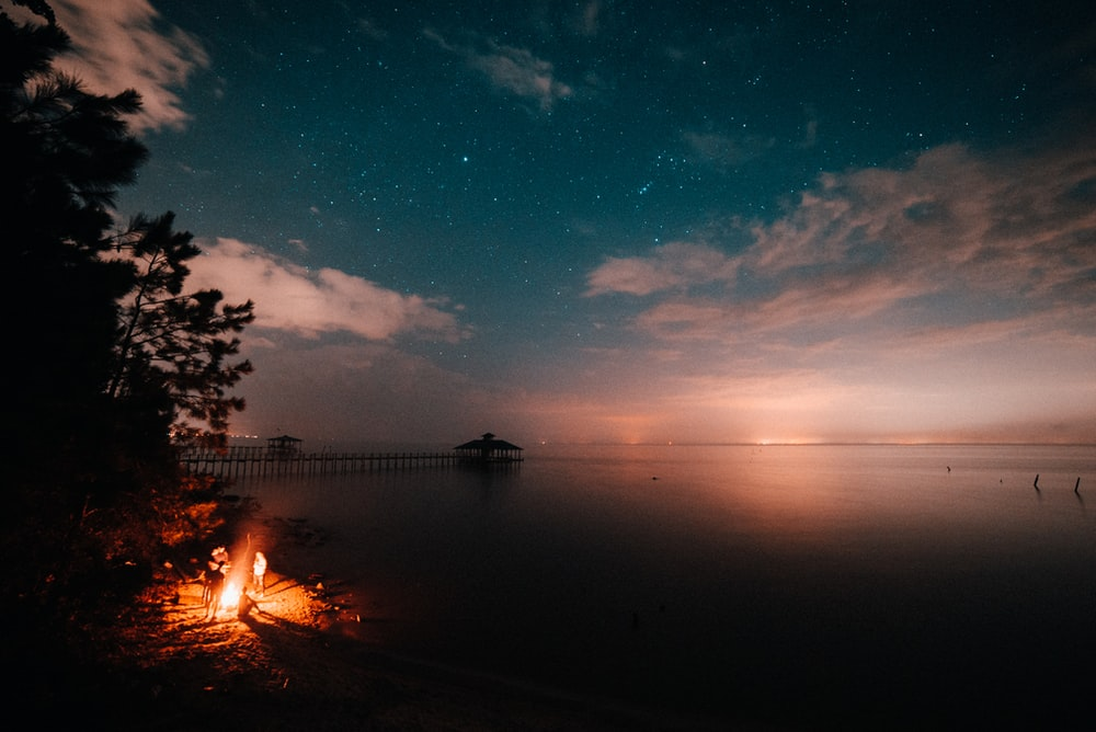 campfire with body of water
