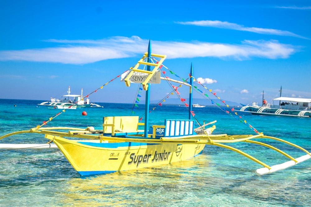 docked yellow sailboat