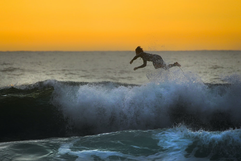surfer crash on body of water