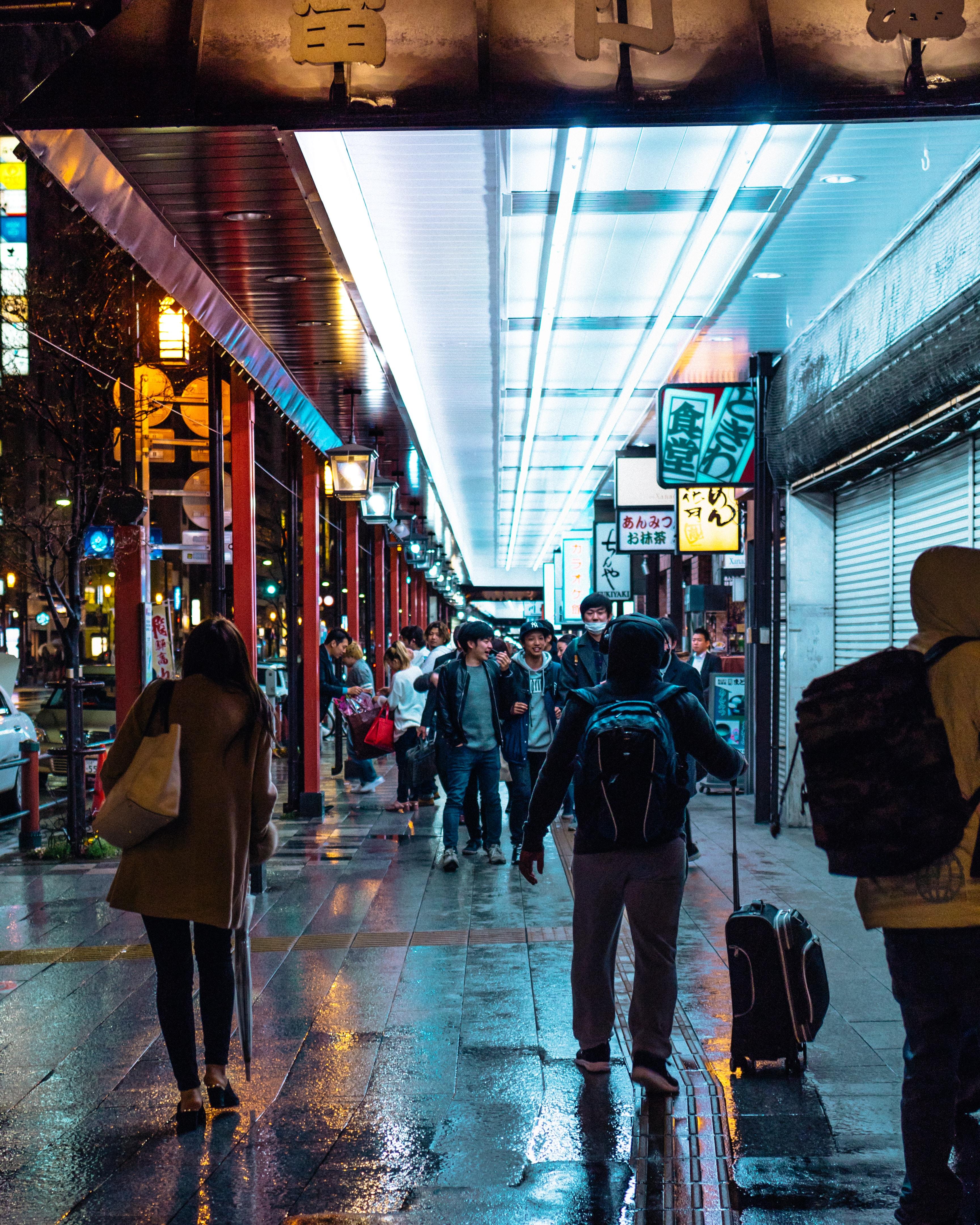 man holding luggage bag while walking