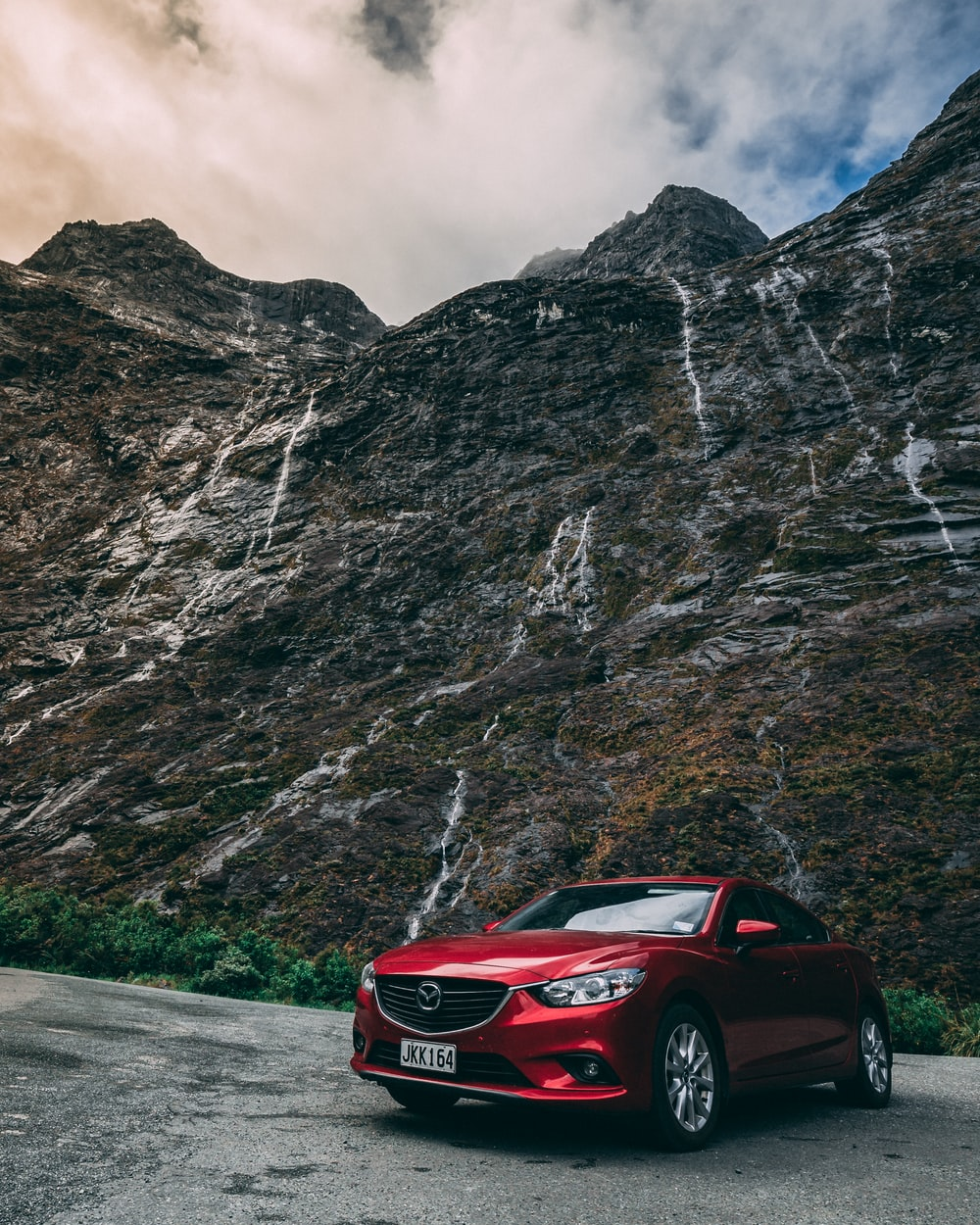 red Mazda vehicle