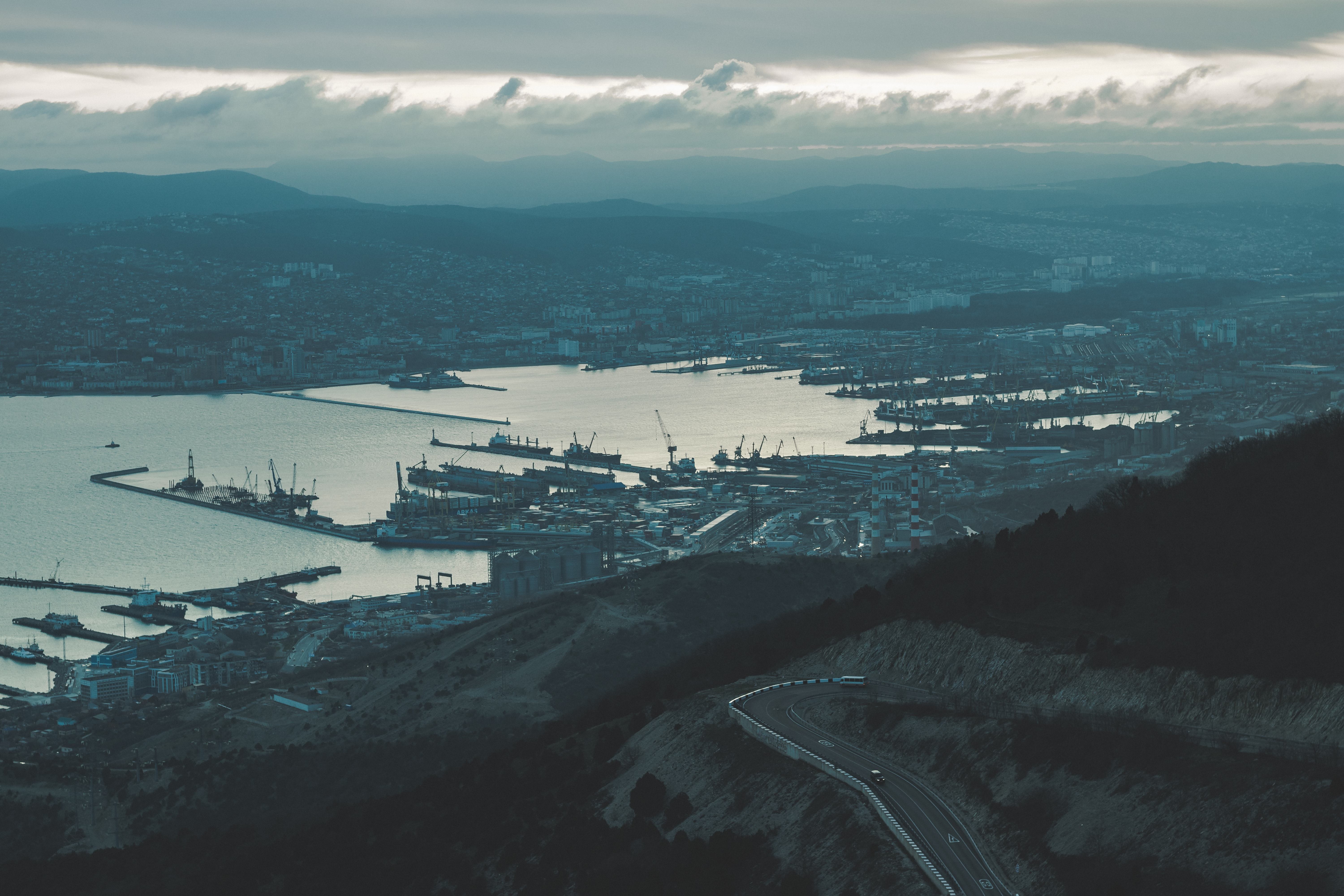 aerial photography of port near hill