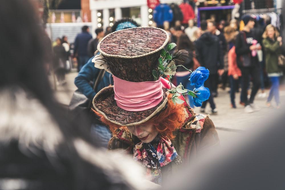 man wearing hat bowing