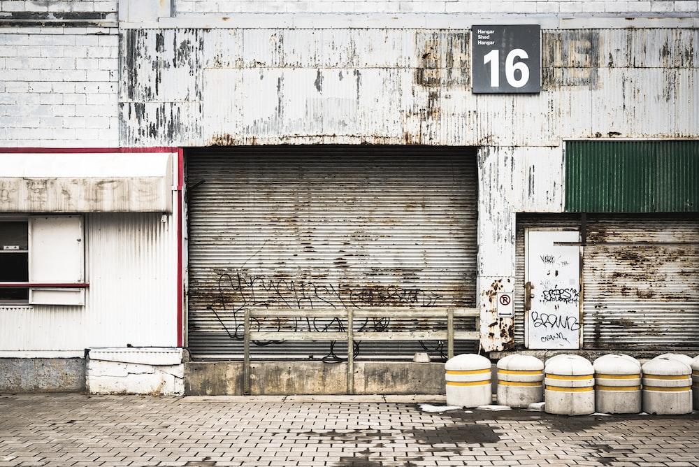 closed gray roll-up doors below 16 signage