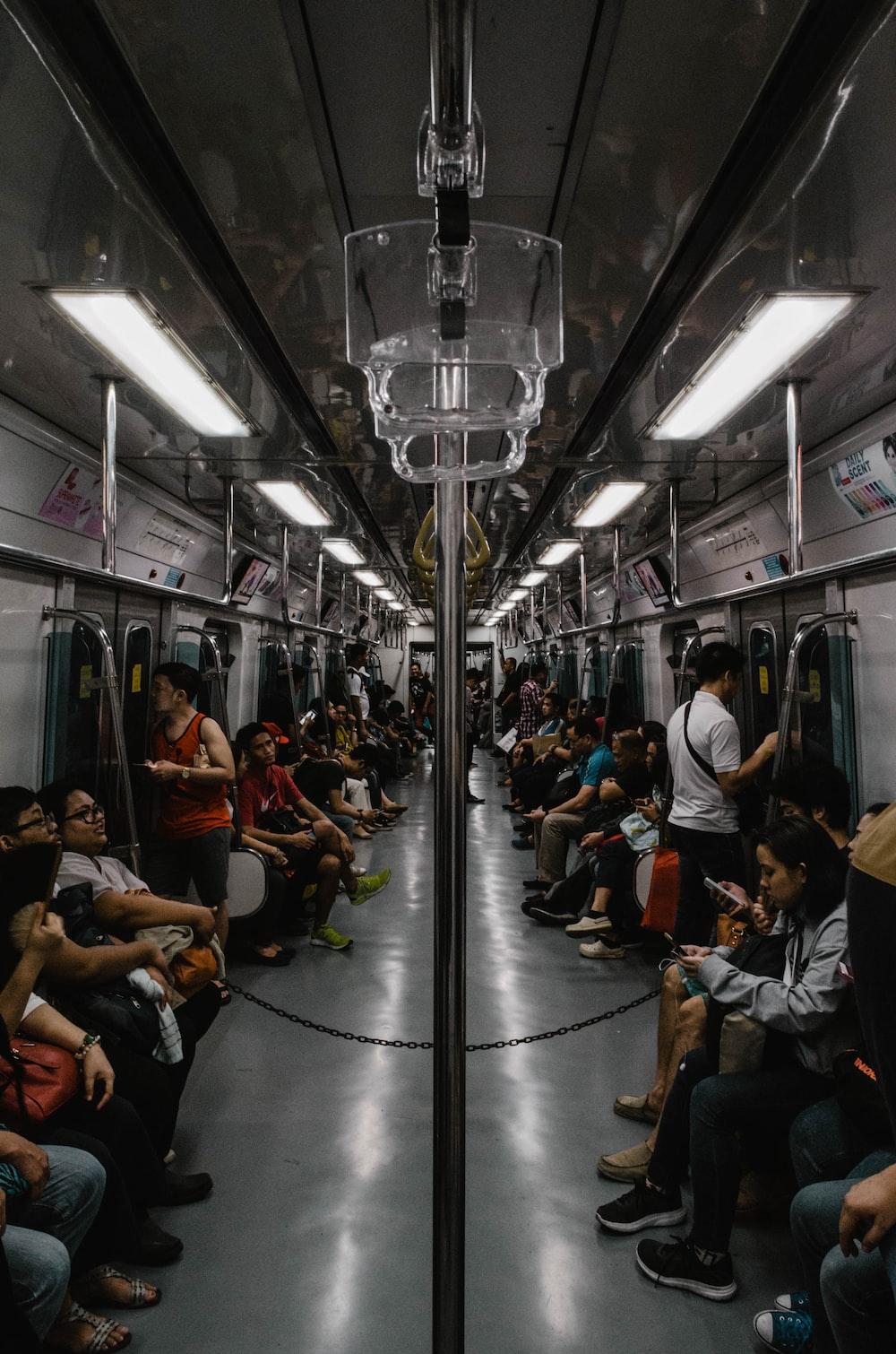 people sitting inside train