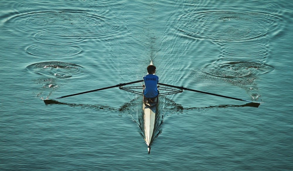 person sailing on body of water