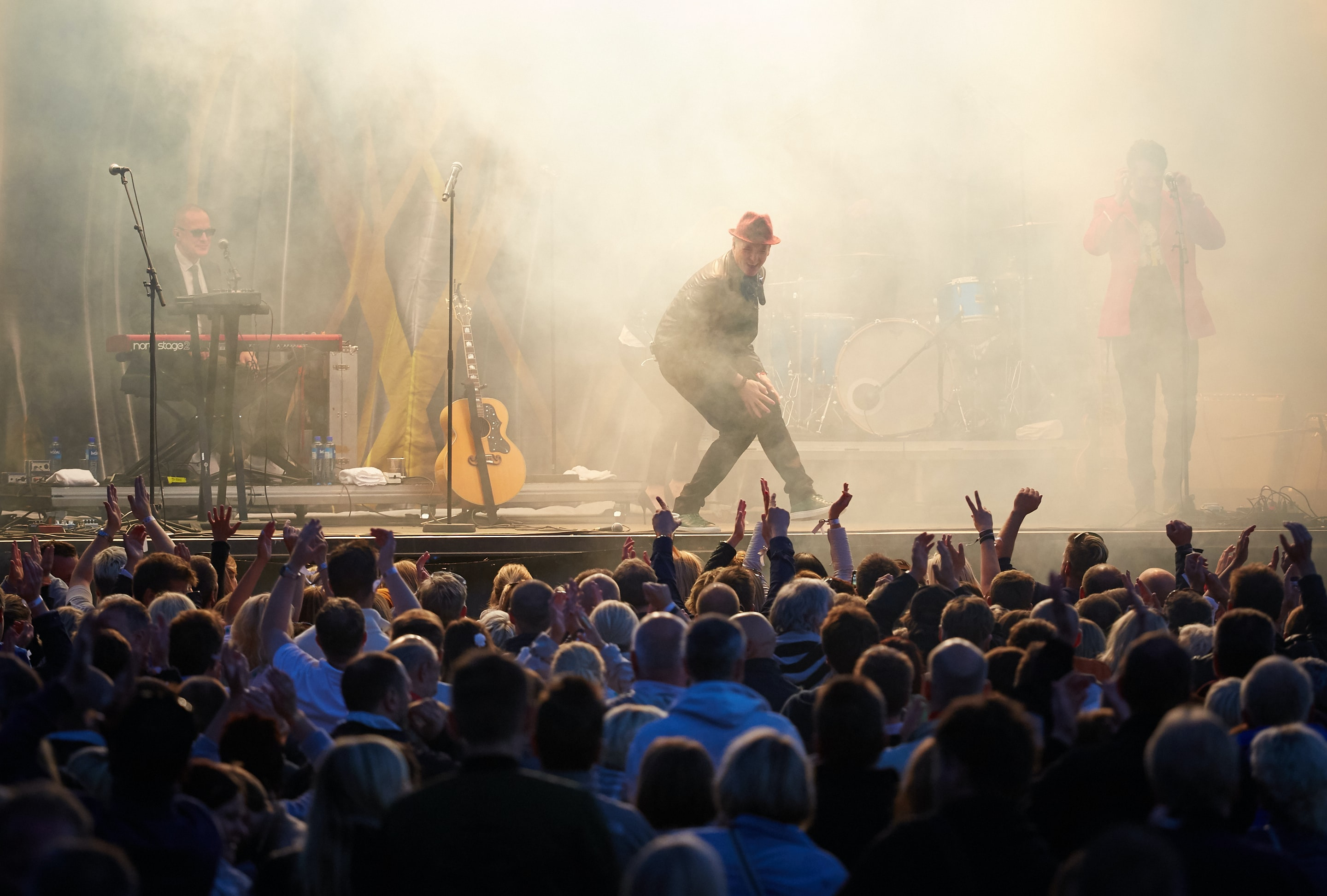 man on stage with crowd