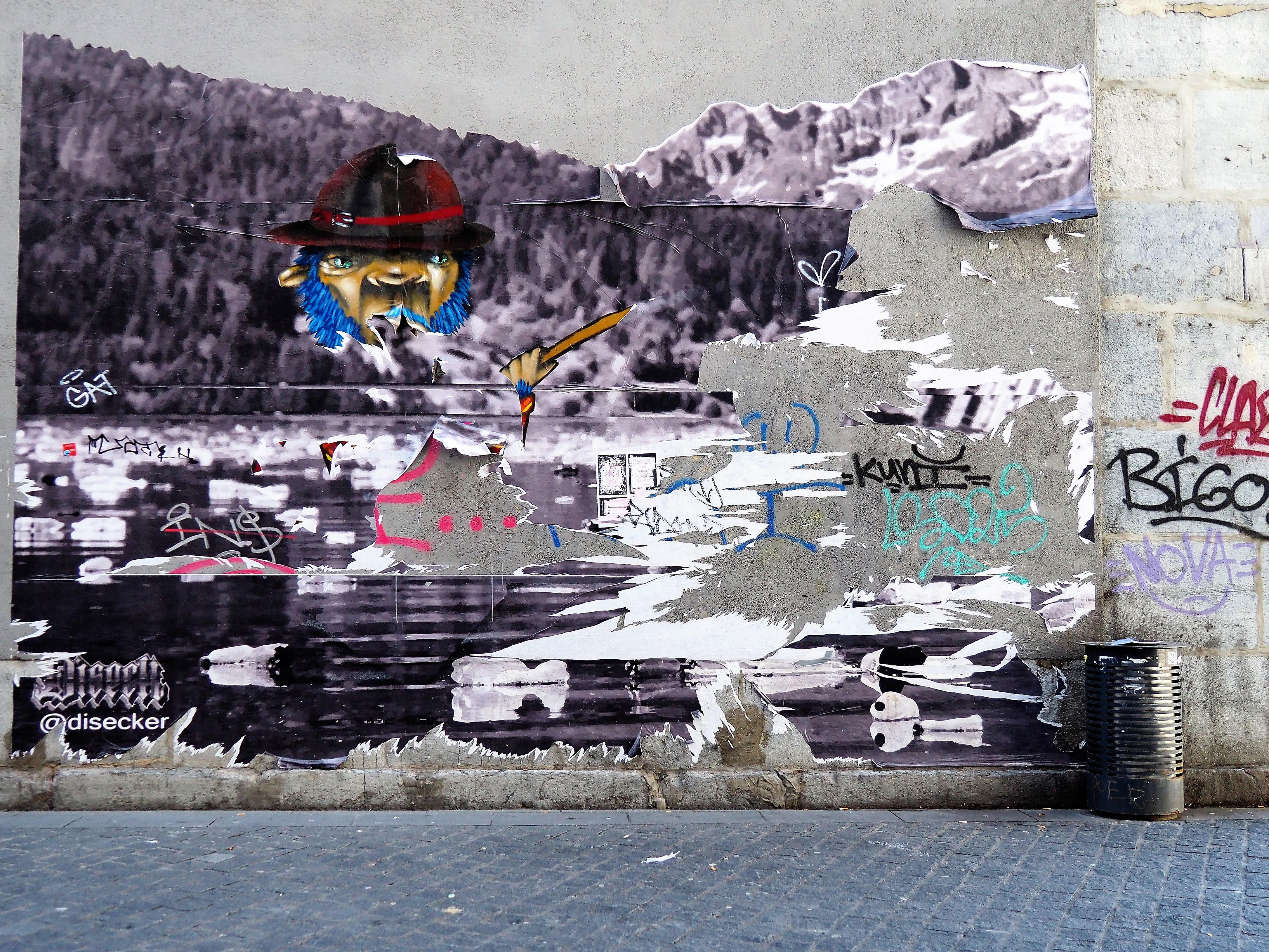 gray wall with mural and graffiti