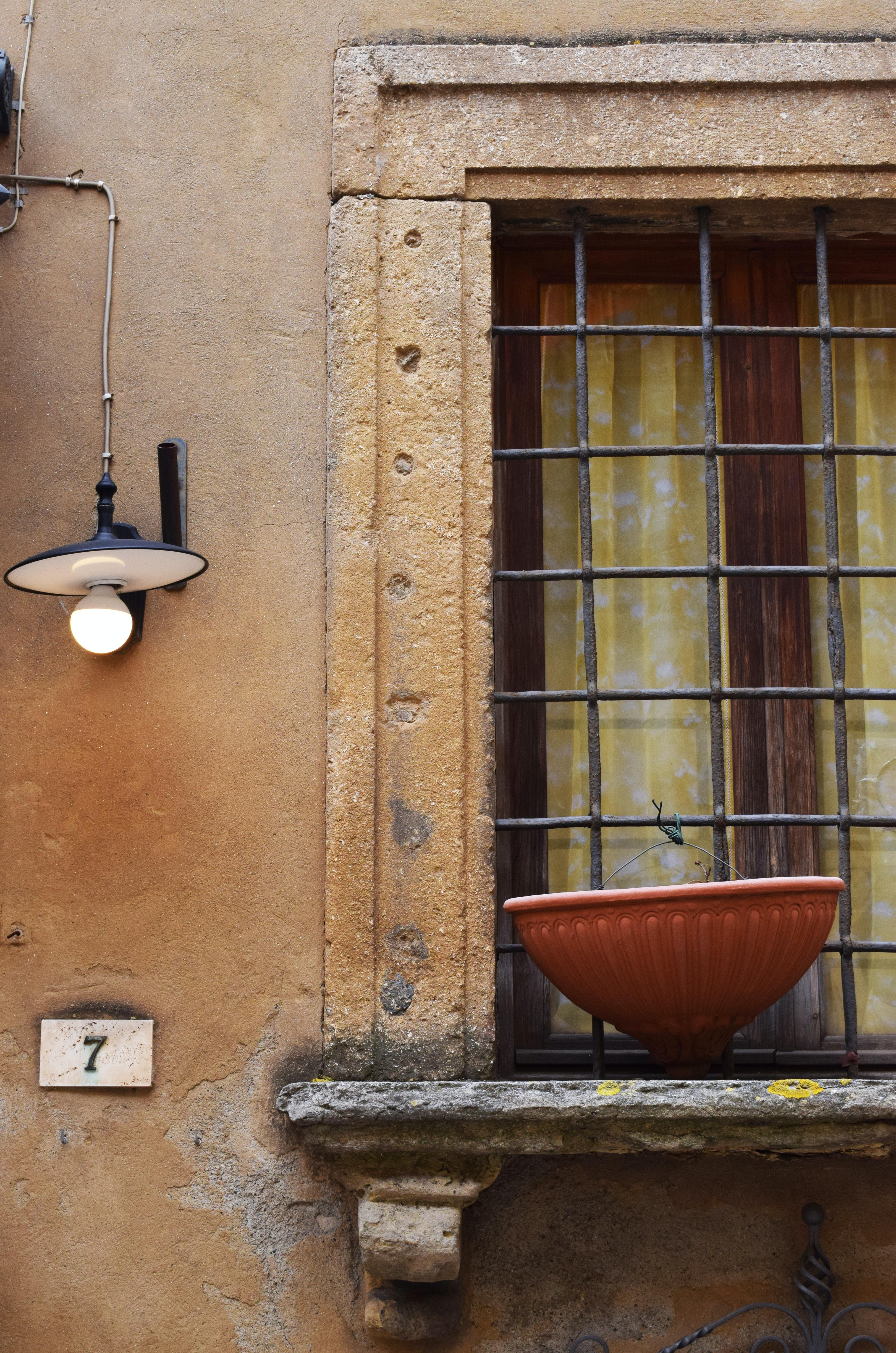 brown planter pot on window