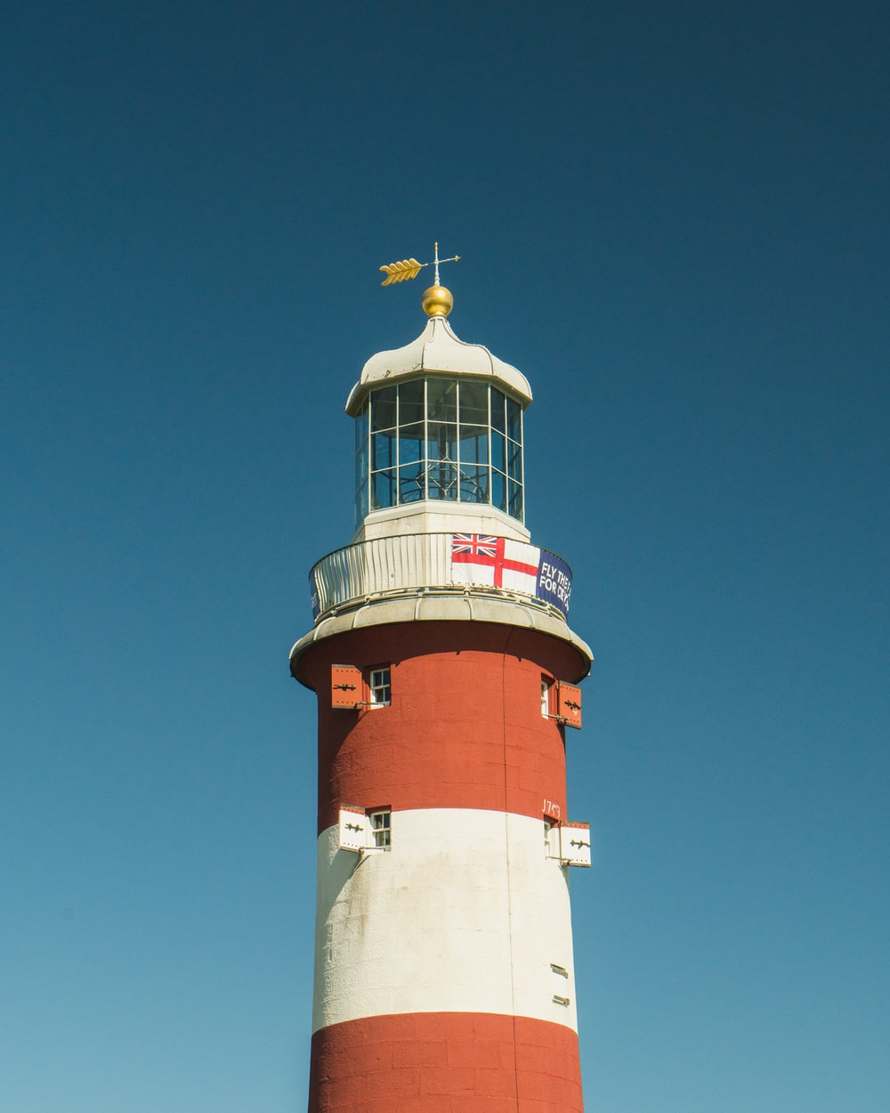 red and white lighthouse during daytime