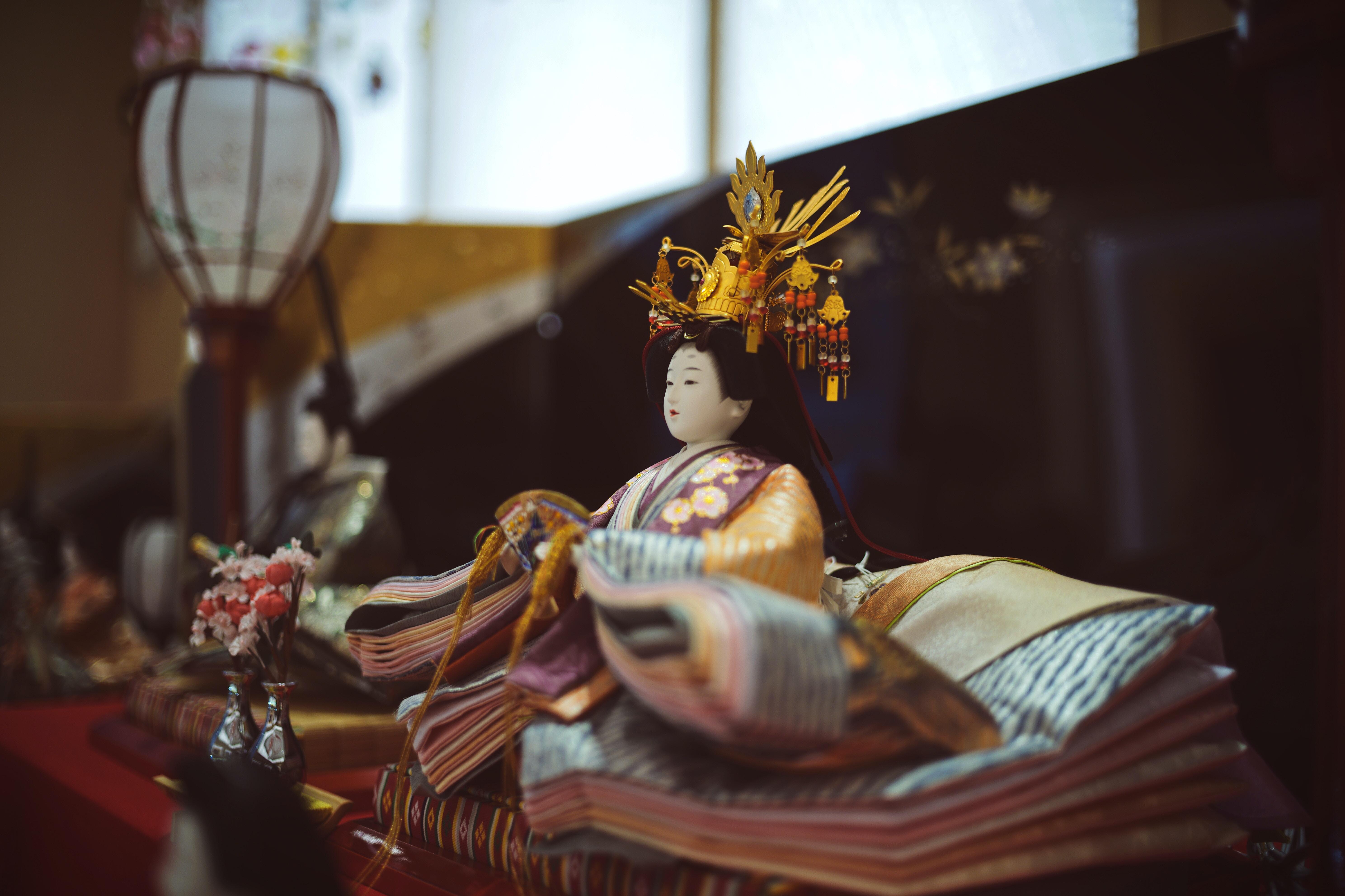 Geisha doll on table