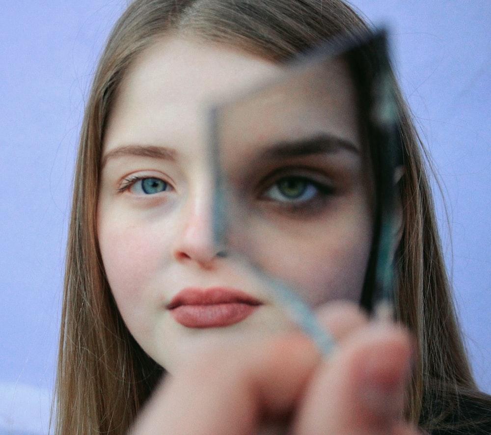 woman holding glass piece