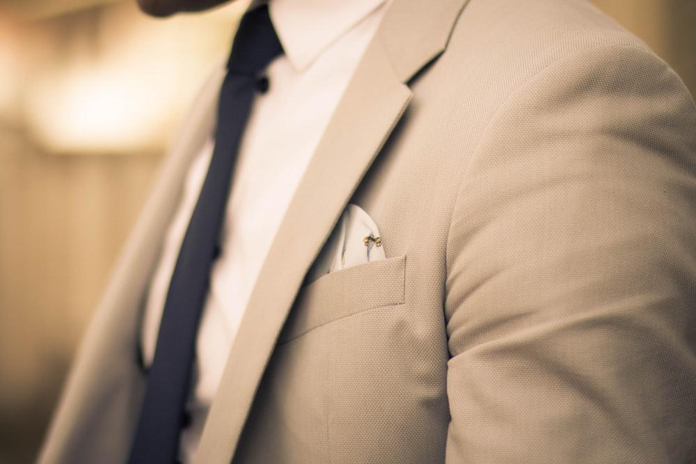 man wearing beige coat